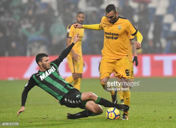 Luca Mazzitelli of US Sassuolo and Mohamed Fares of Hellas Verona FC in action during the Serie A match between US Sassuolo and Hellas Verona FC at...