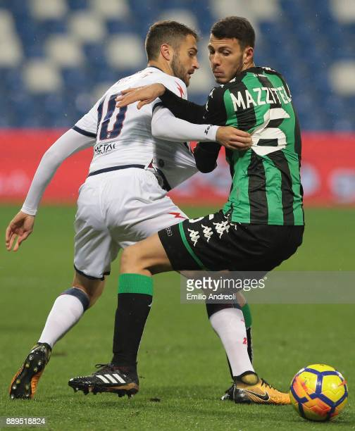 Luca Mazzitelli of US Sassuolo Calcio competes for the ball with Andrea Barberis of FC Crotone during the Serie A match between US Sassuolo and FC...