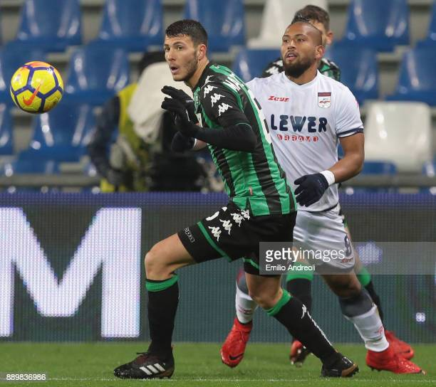 Luca Mazzitelli of US Sassuolo Calcio is challenged by Aristoteles Romero of FC Crotone during the Serie A match between US Sassuolo and FC Crotone...