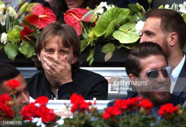 Luca Modric of Real Madrid and Croatia watches on as Rafael Nadal plays Felix AugerAliassime during day five of the Mutua Madrid Open at La Caja...