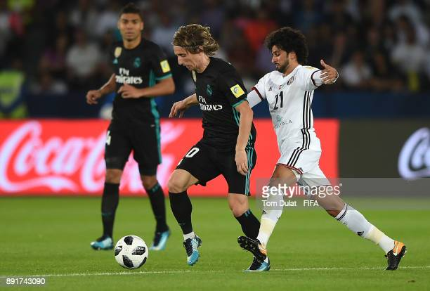 Luca Modric of Real Madrid and Yaqoub Al Hosani of Al Jazira battle for the ball during the FIFA Club World Cup UAE 2017 semi final match between Al...