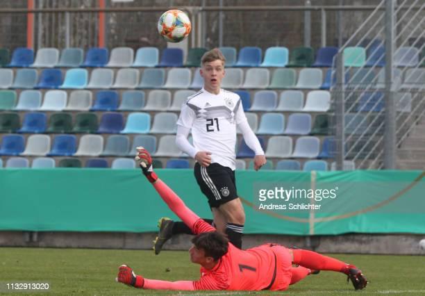 Luca Netz of Germany U17 scores the opening goal past Klemen Hvalic of Slovenia U17 during the UEFA Elite Round match between Germany U17 and...