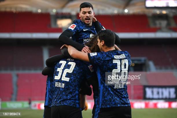 Luca Netz of Hertha BSC celebrates with teammates Nemanja Radonjic, and Sami Khedira after scoring his team's first goal during the Bundesliga match...