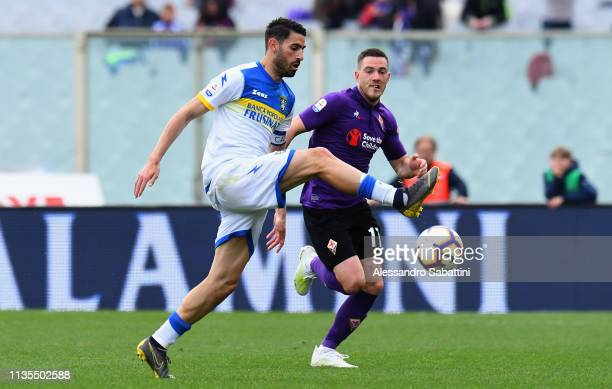 Luca Paganini of Frosinone Calcio competes for the ball with Jordan Veretout of ACF Fiorentina during the Serie A match between ACF Fiorentina and...