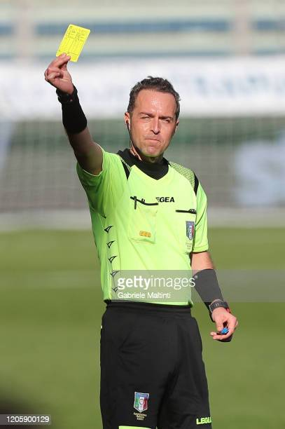 Luca Pairetto referee hold sup a yellow card during the Serie A match between Parma Calcio and SPAL at Stadio Ennio Tardini on March 8 2020 in Parma...