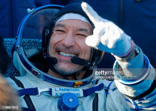 Luca Parmitano of the European Space Agency gestures shortly after landing in a remote area outside the town of Dzhezkazgan Kazakhstan on February 6...