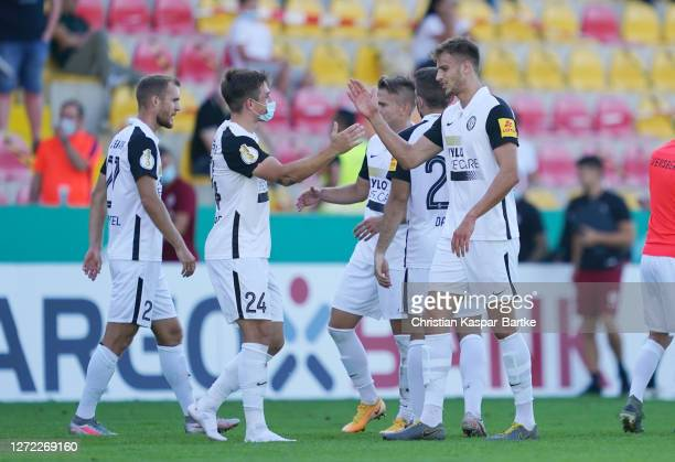 Luca Pascal Schnellbacher and Thomas Gosweiner of SV Elversberg celebrate victory after the DFB Cup first round match between SV Elversberg and FC...
