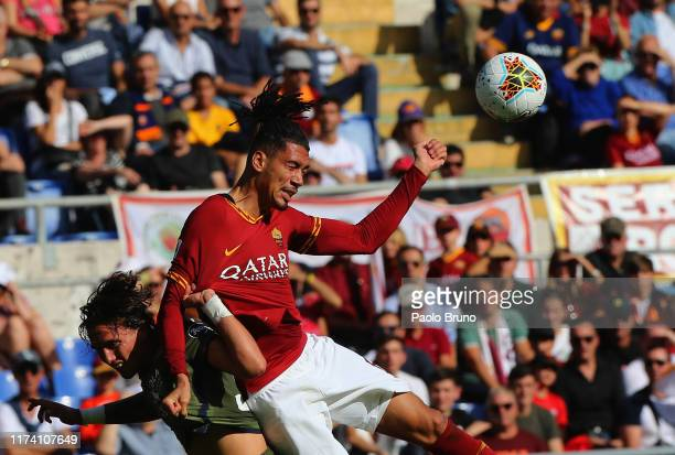 Luca Pellegrini of Cagliari Calcio competes for the ball with Chris Amalling of AS Roma during the Serie A match between AS Roma and Cagliari Calcio...