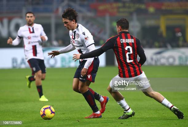 Luca Pellegrini of Cagliari Calcio competes for the ball with Davide Calabria of AC Milan during the Serie A match between AC Milan and Cagliari at...