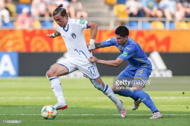 Luca Pellegrini of Italy and Denys Popov of Ukraine are seen in action during the FIFA U-20 World Cup match between Ukraine and Italy in Gdynia. .