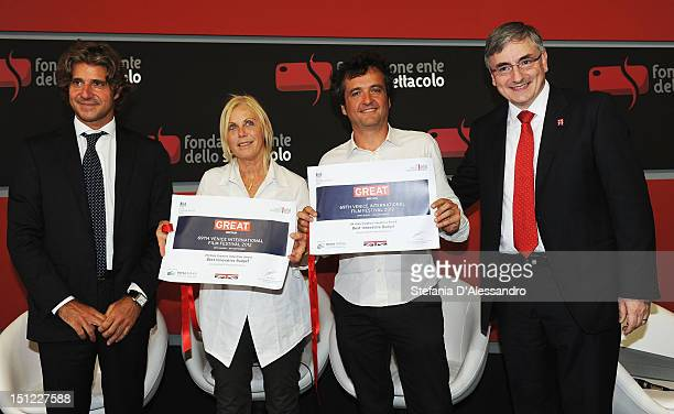 Luca Peyrano producers Tiziana Soudani Carlo CrestoDina and Vic Annels pose with the UKItaly Creative Industries Award during the 69th Venice Film...