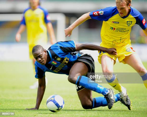 Luca Rigoni of AC Chievo Verona and Mario Balotelli of Inter Milan in action during the Serie A match between AC Chievo Verona and Inter Milan at the...