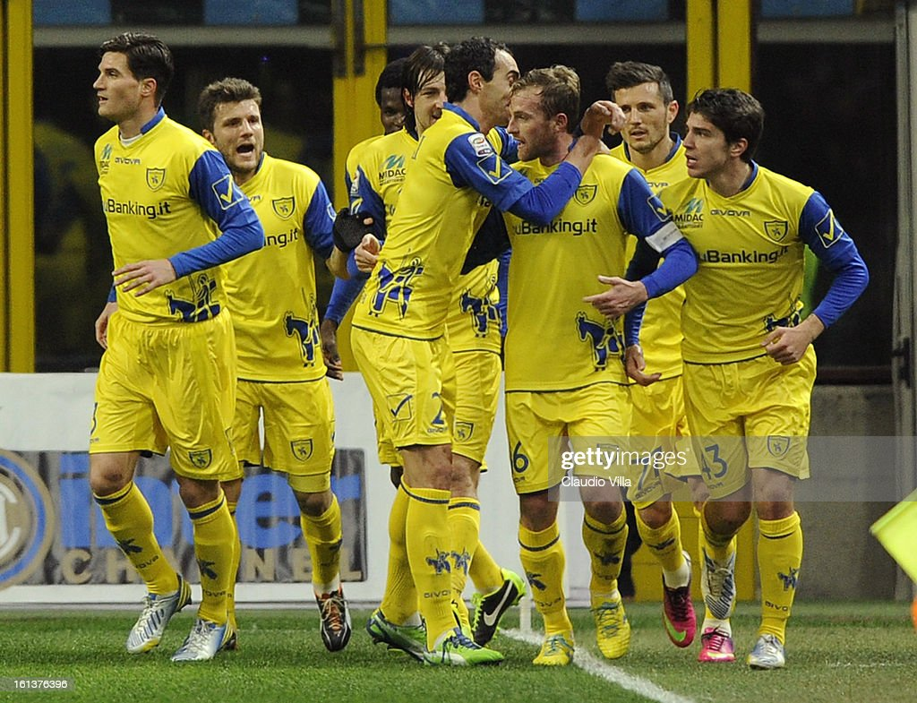Luca Rigoni of AC Chievo Verona (C) celebrates with team-mates after scoring his team's first goal to equalise during the Serie A match between FC Internazionale Milano and AC Chievo Verona at San Siro Stadium on February 10, 2013 in Milan, Italy.