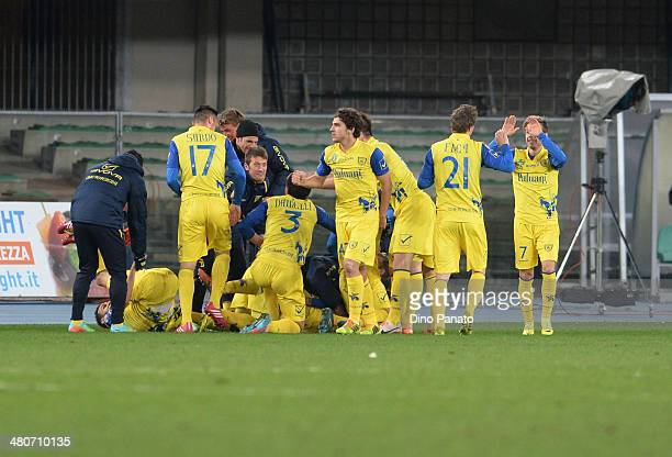 Luca Rigoni of Chievo Verona is mobbed by team mates after scoring his team's third goal during the serie A match between AC Chievo Verona and...