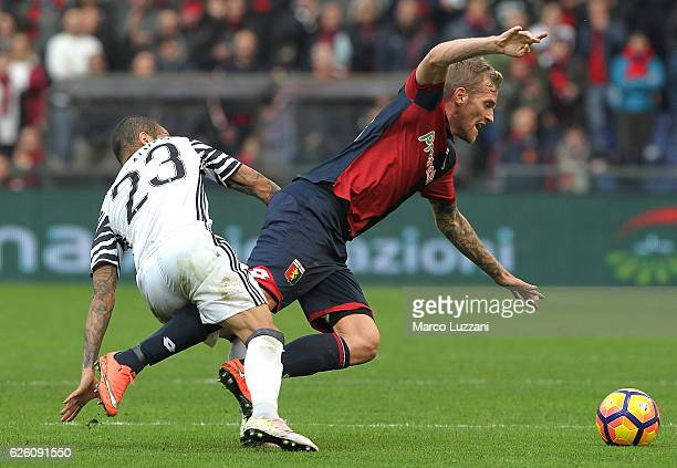 Luca Rigoni of Genoa CFC competes for the ball with Daniel Alves da Silva of Juventus FC during the Serie A match between Genoa CFC and Juventus FC...