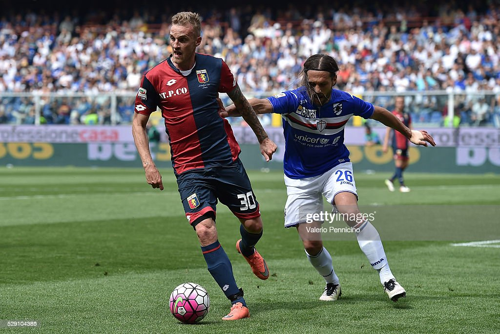 Luca Rigoni (L) of Genoa CFC is challenged by Matias Agustin Silvestre of UC Sampdoria during the Serie A match between UC Sampdoria and Genoa CFC at Stadio Luigi Ferraris on May 8, 2016 in Genoa, Italy.
