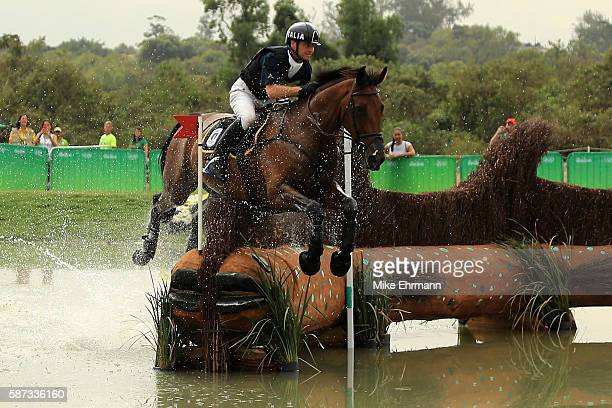 Luca Roman of Italy riding Castlewoods Jake clears a water jump during the Cross Country Eventing on Day 3 of the Rio 2016 Olympic Games at the...