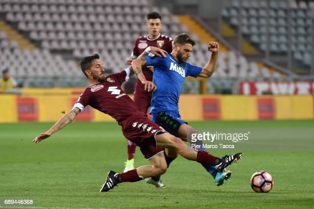 Luca Rosettini of FC Torino competes for the ball with Domenico Berardi of US Sassuolo during the Serie A match between FC Torino and US Sassuolo at...