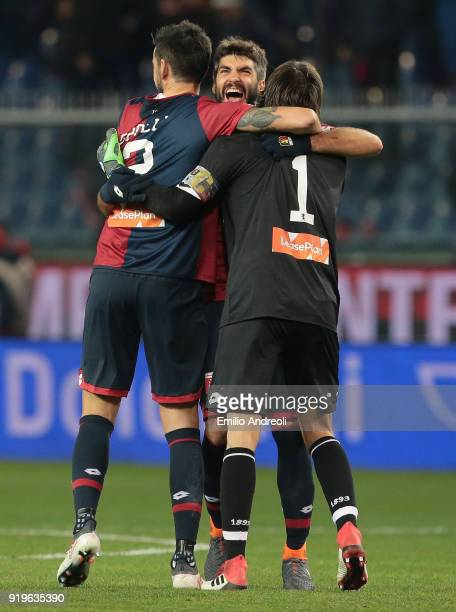 Luca Rossettini of Genoa CFC celebrates the victory with his team mate Mattia Perin and Nicolas Spolli at the end of the serie A match between Genoa...