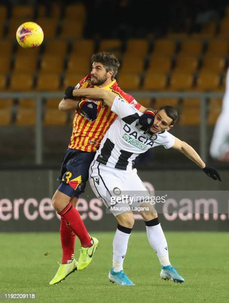 Luca Rossettini of Lecce competes for the ball with Kevin Lasagna of Udinese during the Serie A match between US Lecce and Udinese Calcio at Stadio...
