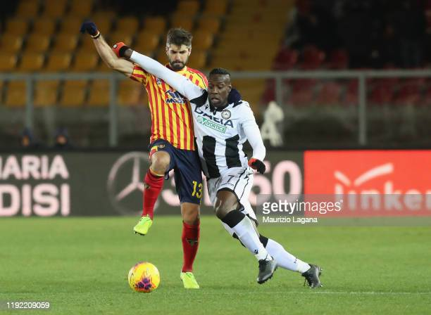 Luca Rossettini of Lecce competes for the ball with Stefano Okaka of Udinese during the Serie A match between US Lecce and Udinese Calcio at Stadio...