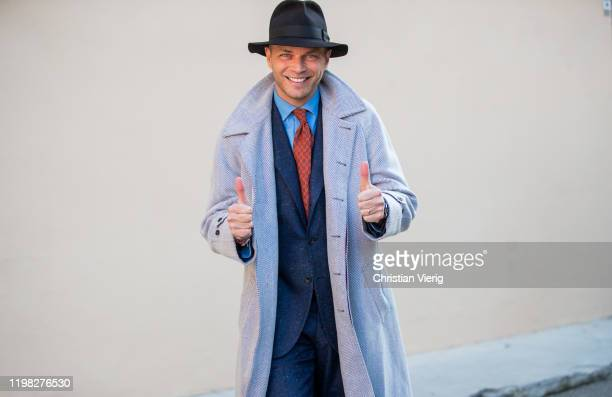 Luca Rubinacci seen wearing grey coat, tie, navy blazer, hat during Pitti Uomo 97 at Fortezza Da Basso on January 08, 2020 in Florence, Italy.