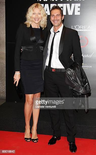 Luca Sabbioni and Natasha Stefanenko attend the FABFIVE Vanity Fair Party at Milan Fashion Week Womenswear Spring/Summer 2009 held at Triennale...