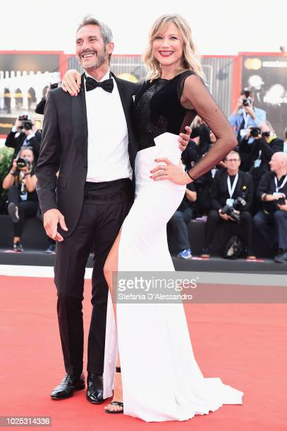 Luca Sabbioni and Natasha Stefanenko walk the red carpet ahead of the 'Roma' screening during the 75th Venice Film Festival at Sala Grande on August...