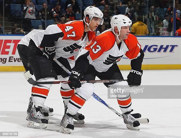 Luca Sbisa and Glen Metropolit of the Philadelphia Flyers skates against the New York Islanders on November 11 2008 at Nassau Coliseum in Uniondale...