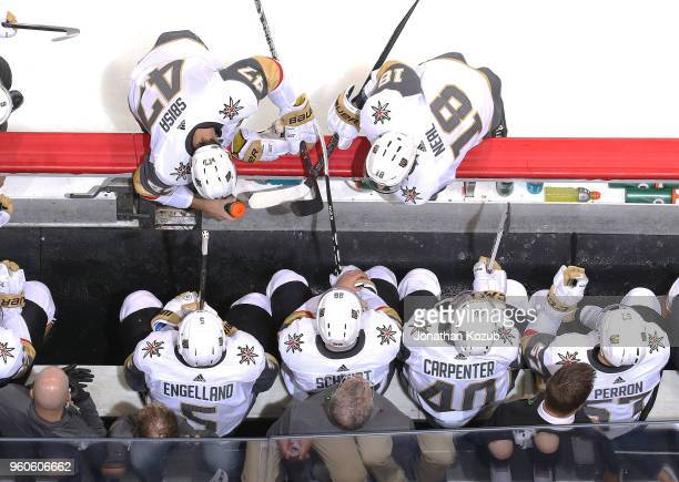 Luca Sbisa and James Neal of the Vegas Golden Knights chat with teammates at the bench during a second period stoppage in play against the Winnipeg...
