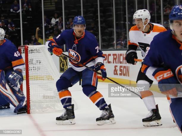 Luca Sbisa of the New York Islanders defends against the Philadelphia Flyers during a preseason game at the Nassau Veterans Memorial Coliseum on...