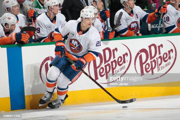 Luca Sbisa of the New York Islanders handles the puck against the Dallas Stars at the American Airlines Center on December 23 2018 in Dallas Texas