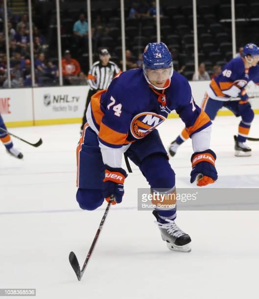 Luca Sbisa of the New York Islanders skates against the Philadelphia Flyers during a preseason game at the Nassau Veterans Memorial Coliseum on...