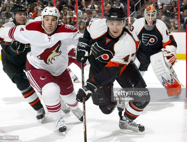 Luca Sbisa of the Philadelphia Flyers cuts in front of Daniel Carcillo of the Phoenix Coyotes as they chase after a loose puck on November 22, 2008...