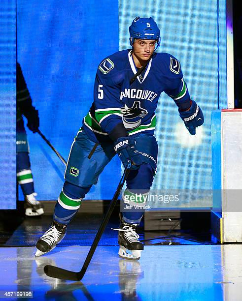 Luca Sbisa of the Vancouver Canucks steps onto the ice during their NHL game against the Edmonton Oilers at Rogers Arena October 11 2014 in Vancouver...