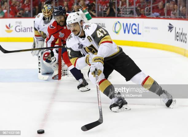 Luca Sbisa of the Vegas Golden Knights is chased by Devante SmithPelly of the Washington Capitals during the first period of Game Four of the 2018...