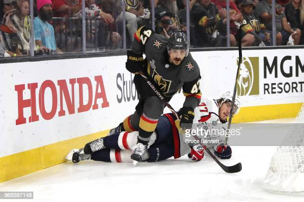 Luca Sbisa of the Vegas Golden Knights skates against John Carlson of the Washington Capitals during the first period in Game Five of the 2018 NHL...
