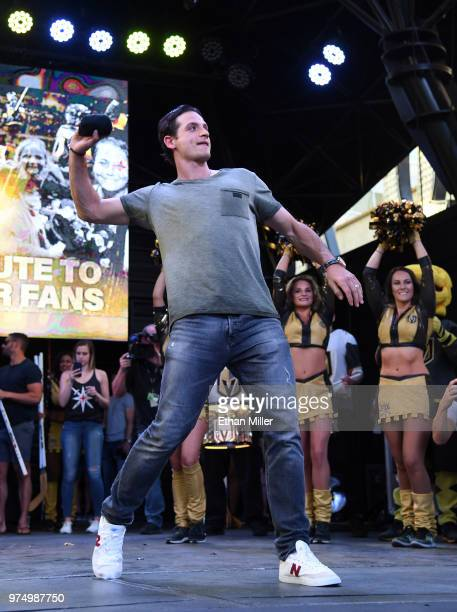 Luca Sbisa of the Vegas Golden Knights throws Tshirts to the crowd as he is introduced at the team's 'Stick Salute to Vegas and Our Fans' event at...