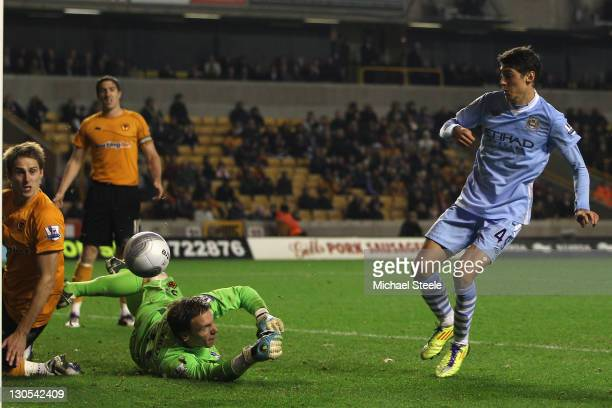 Luca Scapuzzi of Manchester City scores his sides fourth goal during the Carling Cup Fourth Round match at Molineux on October 26 2011 in...
