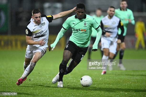 Luca Schnellbacher of SV Elversberg battles for possession with Breel Embolo of Borussia Monchengladbach during the DFB Cup second round match...