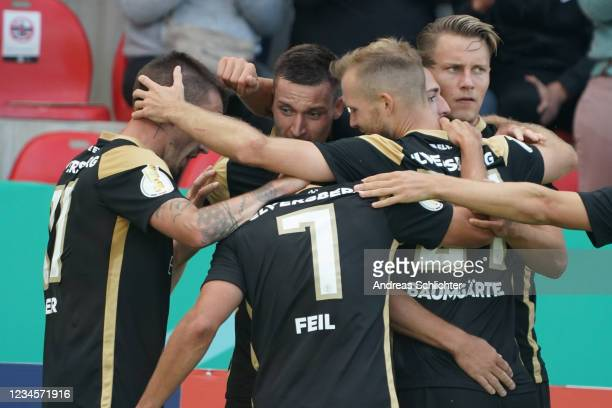 Luca Schnellbacher of SV Elversberg celebrates with team-mates after scoring a goal during the DFB Cup first round match between SV 07 Elversberg and...