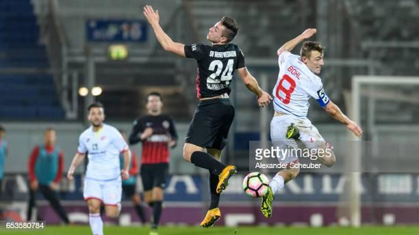 Luca Schnellbacher of Wiesbaden challenges Daniel Bohl of Mainz during the Third League match between SV Wehen Wiesbaden and FSV Mainz 05 II at...