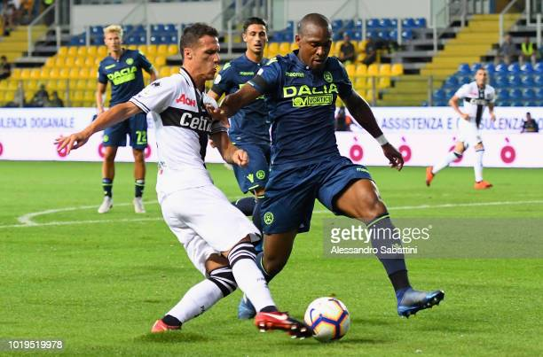 Luca Silingardi of Parma Calcio competes for the ball with Gaetano De Souza Santos Samir of Udinese Calcio during the serie A match between Parma...