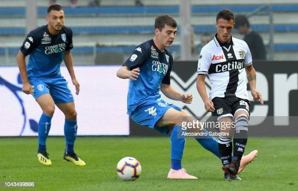 Luca Silingardi of Parma Calcio competes for the ball with Jabok Rasmussen of Empoli Fc during the Serie A match between Parma Calcio and Empoli at...