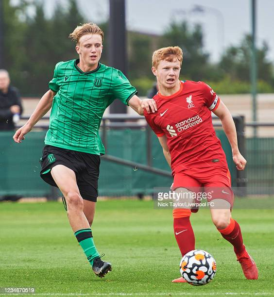 Luca Stephenson of Liverpool and Jack Griffiths of Stoke City in action during the U18 Premier League game at AXA Training Centre on August 14, 2021...