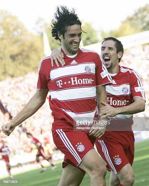 Luca Toni and Franck Ribery of Munich celebrate the 10 goal by Toni during the Bundesliga match between Karlsruher SC and Bayern Munich at the...
