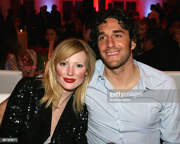 Luca Toni and girlfriend Marta Cecchetto attend the Bayern Munich champions party after the DFB Cup Final match between Borussia Dortmund and FC...