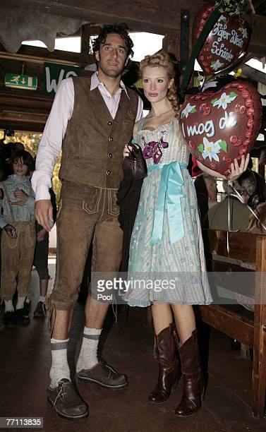 Luca Toni and his girlfriend Marta Cecchetto arrive at the Kaefers party tent for a day at the Oktoberfest on September 30 2007 in Munich Germany