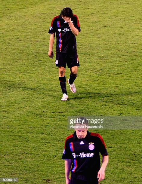 Luca Toni and his team mate Franck Ribery look dejected after the UEFA Cup semi final 2nd leg match between Zenit St. Petersburg and Bayern Munich at...