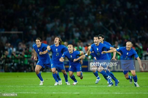 Luca Toni, Andrea Pirlo, Fabio Cannavaro, Daniele De Rossi, Vincenzo Iaquinta, Gianluca Zambrotta and Alessandro Del Piero of Italy celebrate as the...